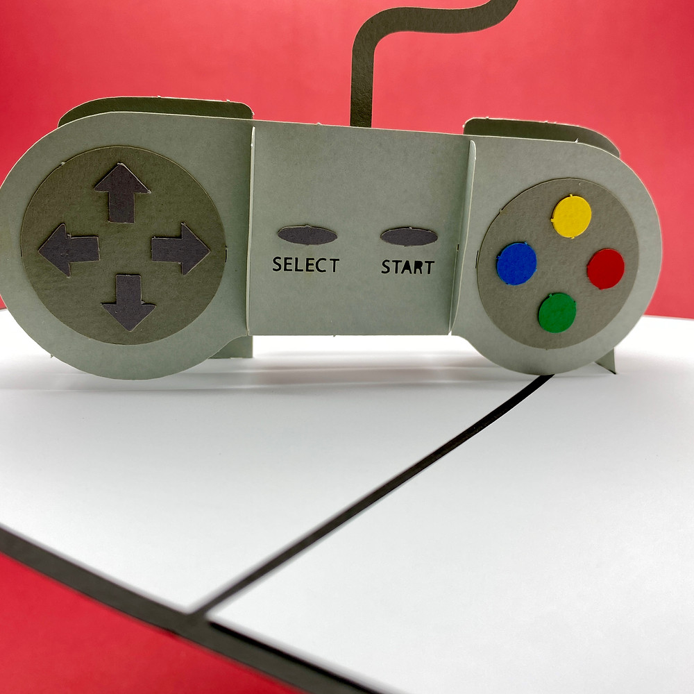 Video game controller pop up card