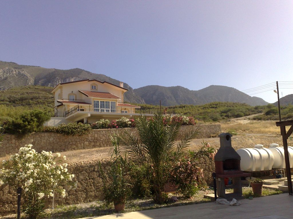 View past the villa to the mountains