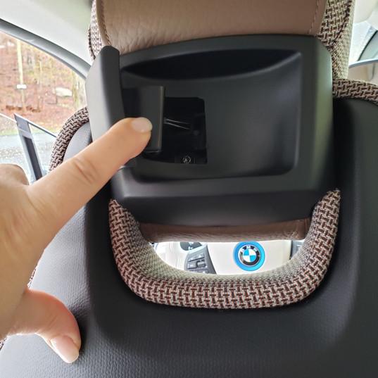 The rear seats fold forward via this headrest handle