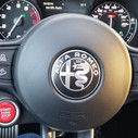 The racing-inspired steering wheel of the 2019 Alfa Romeo Stelvio QV