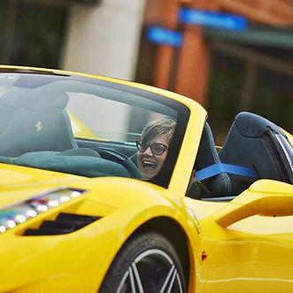 Rebecca drivng Ferrari