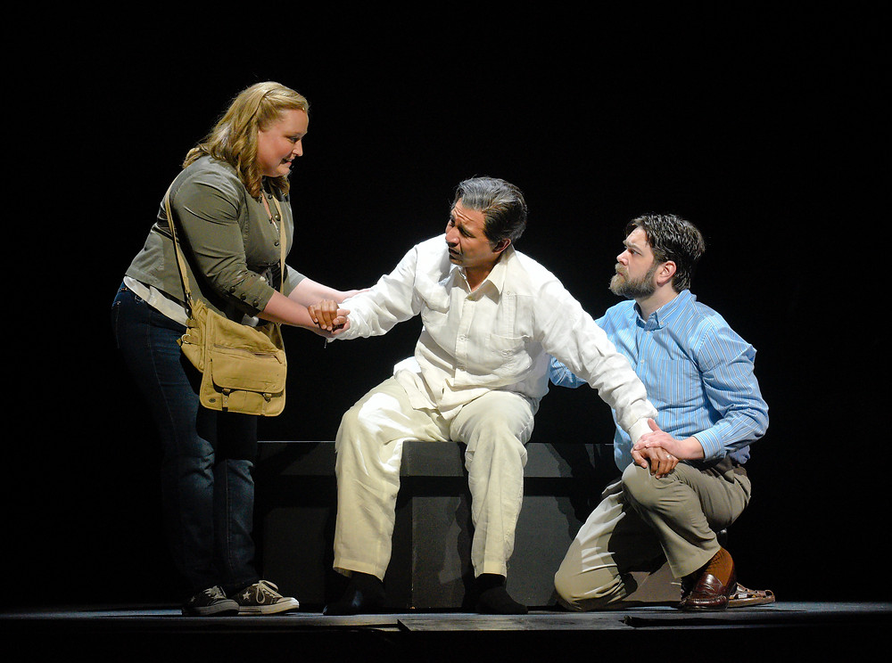 Diana (Brittany Wheeler), left, and Mark (Brian Shircliffe), right, sit beside the bed-ridden Laurentino (Octavio Moreno); photo by Karen Almond.