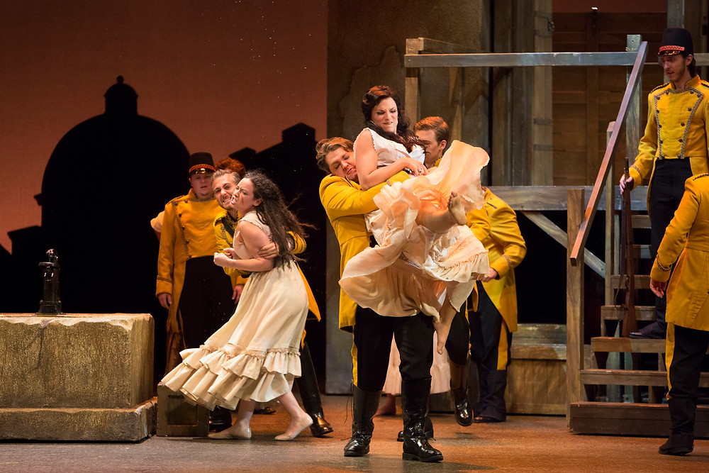 Carmen being arrested in Act I. Photo by Marty Sohl.