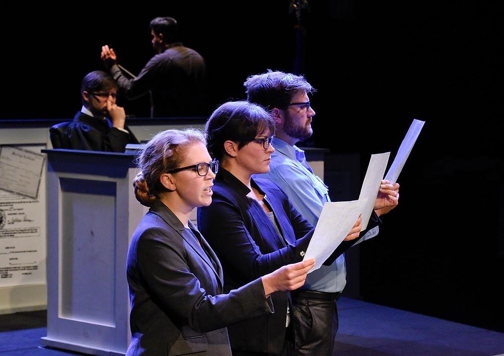Prosecutor Donna Redfield (Christina Pecce), a bailiff (Andrew Surrena), and a stenographer (Anna Laurenzo), in 'Voir Dire'; Karen Almond, Fort Worth Opera
