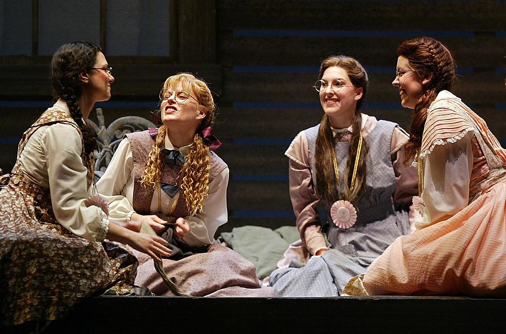 The March sisters Jennifer Dudley as Jo, Sandra Piques Eddy as Meg, Tawny Seward as Beth, and Coral Owdom as Amy). Photo by Ellen Appel.