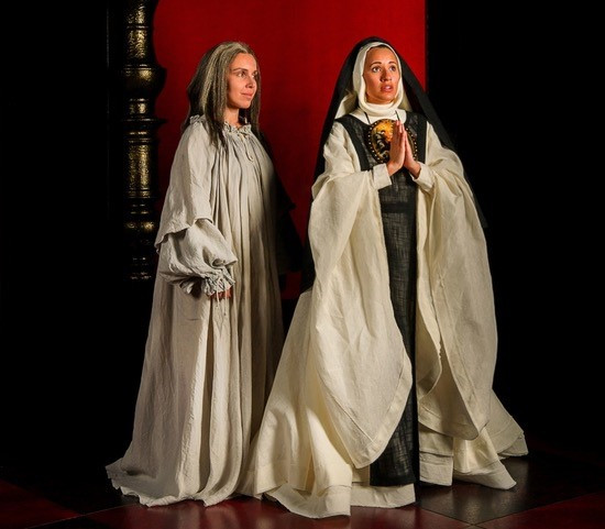 Dying Sor Juana (Sandra Lopez) and Young Sor Juana (Vanessa Becerra) in With Blood With Ink at Fort Worth Opera