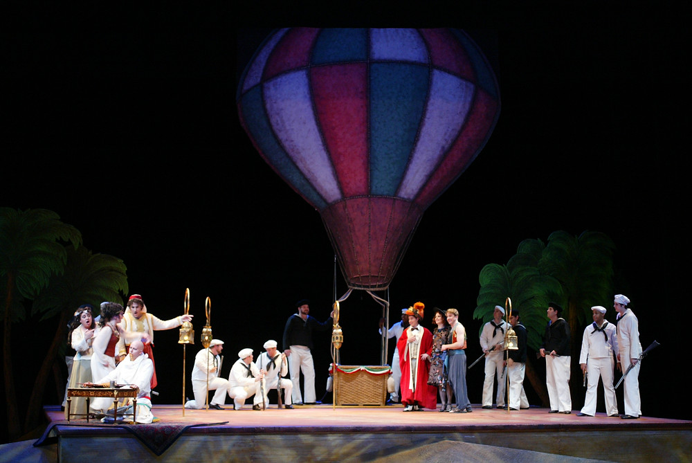 Isabella and Lindoro (Jennifer Dudley and David Adams) prepare to leave in a hot air balloon; photo by Ellen Appel.