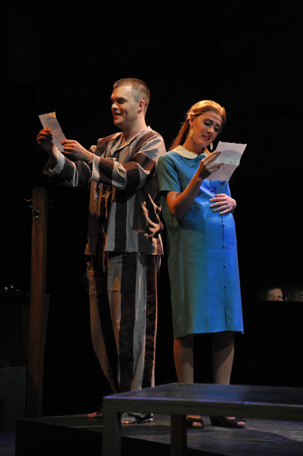 Young Thompson (David Blalock) and Young Alyce (Sydney Mancasola) reading a letter; photo by Ellen Appel.