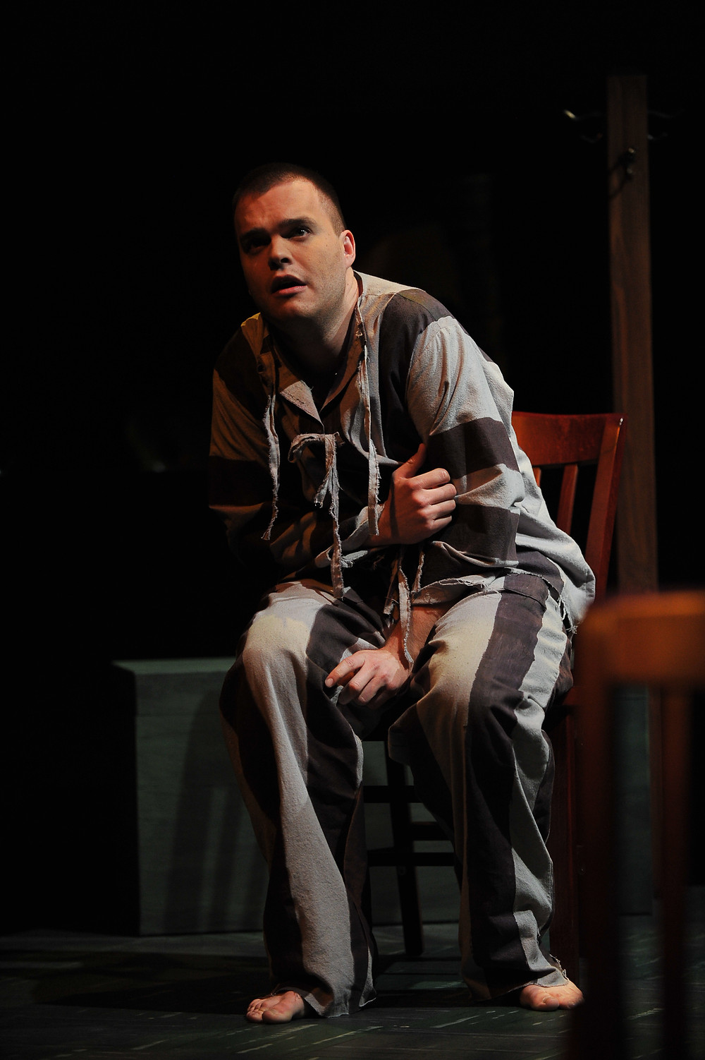 Young Thompson (Jonathan Blalock) alone and scared in the POW camp; photo by Ellen Appel.