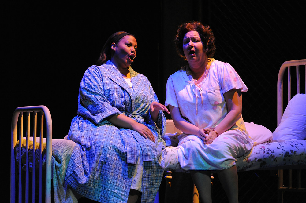 Sister Helen Prejean (Robynne Redmon) seeks comfort in Sister Rose (Adrienne Danrich); photo by Ellen Appel.