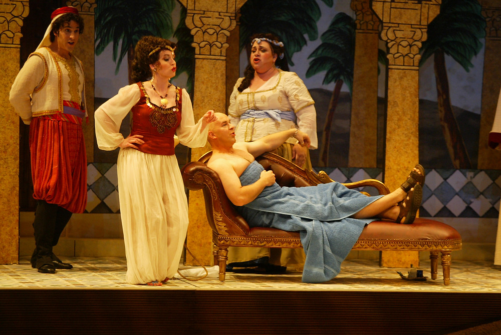 Mustafá (Rod Nelman) sits in his palace as his wife, Elvira (Angela Turner Wilson), laments their marriage. Catering to Mustafá is Ali (David Giuliano) and Zulma (Cindy Sadler); photo by Ellen Appel.