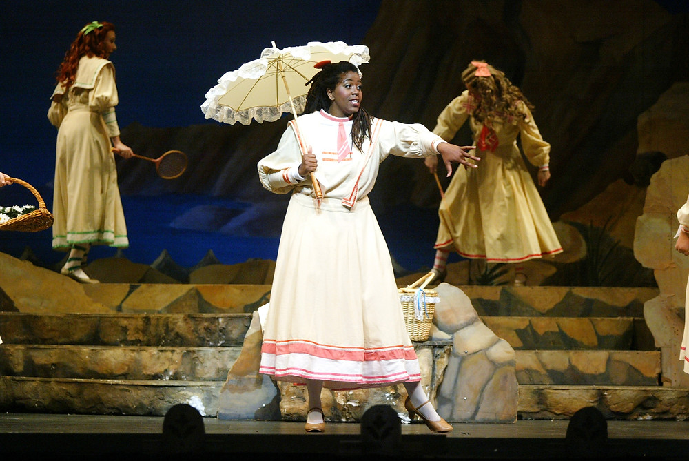 Margaurite Mathis-Clark (Edith) and the Chorus of 'Pirates of Penzance;' Photo by Ellen Appel.