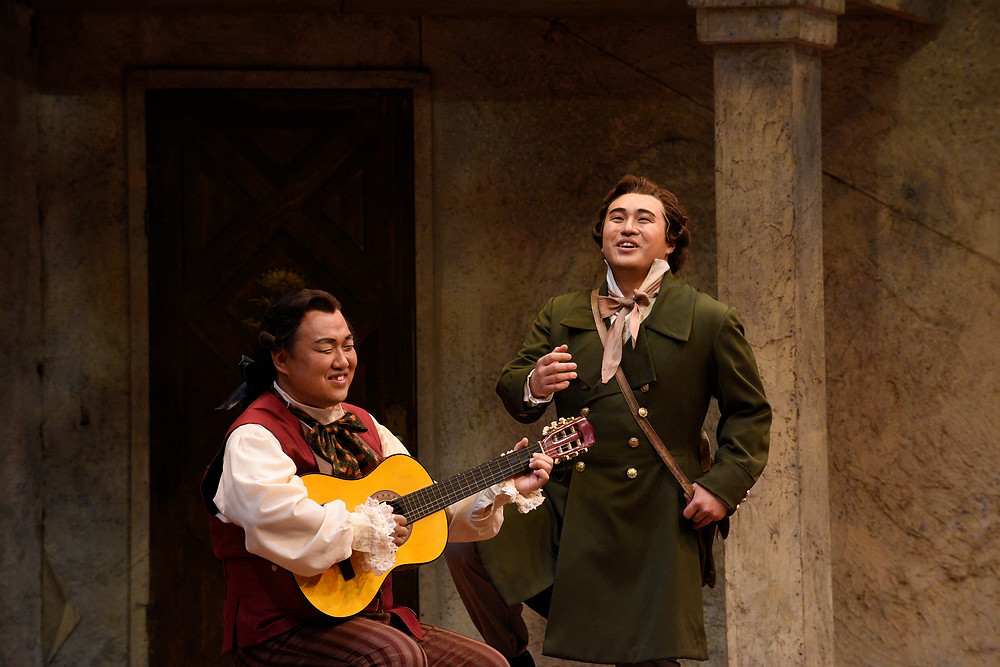 "Left to right, Figaro (Joo Won Kang) and Count Almaviva (Andrew Stenson) playing guitar and singing in ""The Barber of Seville"" FWO 2016; photo by Karen Almond."