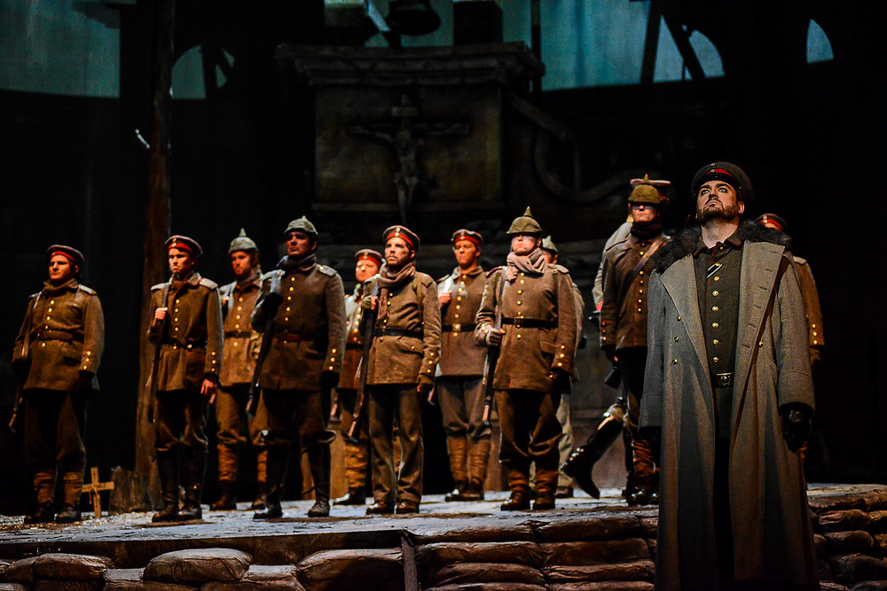 "Soldiers line up for battle. The Fort Worth Opera Chorus in ""Silent Night"" 2014; photo by Karen Almond."