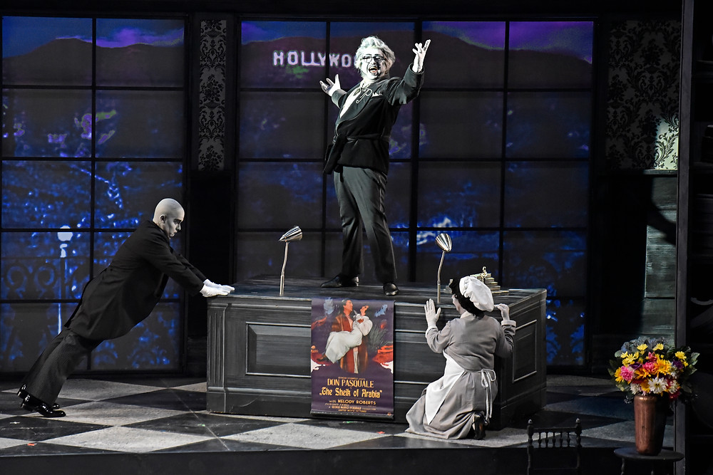 Don Pasquale (Burak Bilgili) with Max the Majordomo (Dustin Curry) and maid (Melinda Massie) in his Sunset Boulevard mansion; Photo by Ben Torres.