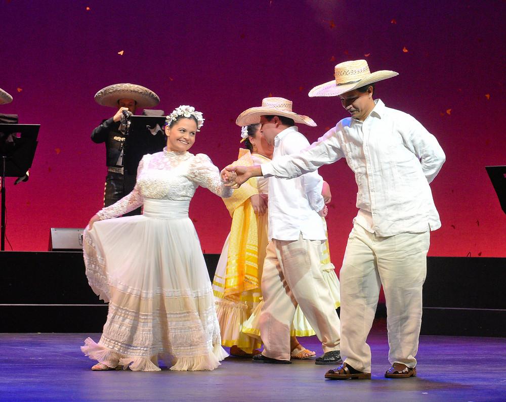 Renata (Cecilia Duarte) and Laurentino (Octavio Moreno) join Lupita (Vanessa Cerda-Alonzo) and her husband Chucho (Saúl_Ávalos) in a dance; photo by Karen Almond.