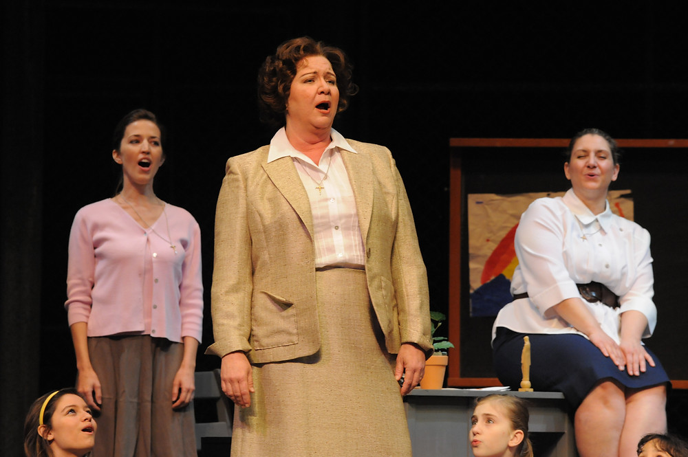 Robynne Redmon (Sister Helen Prejean) with Meredith Browning (Sister Catherine) and the chorus of 'Dead Man Walking'; photo by Ellen Appel.