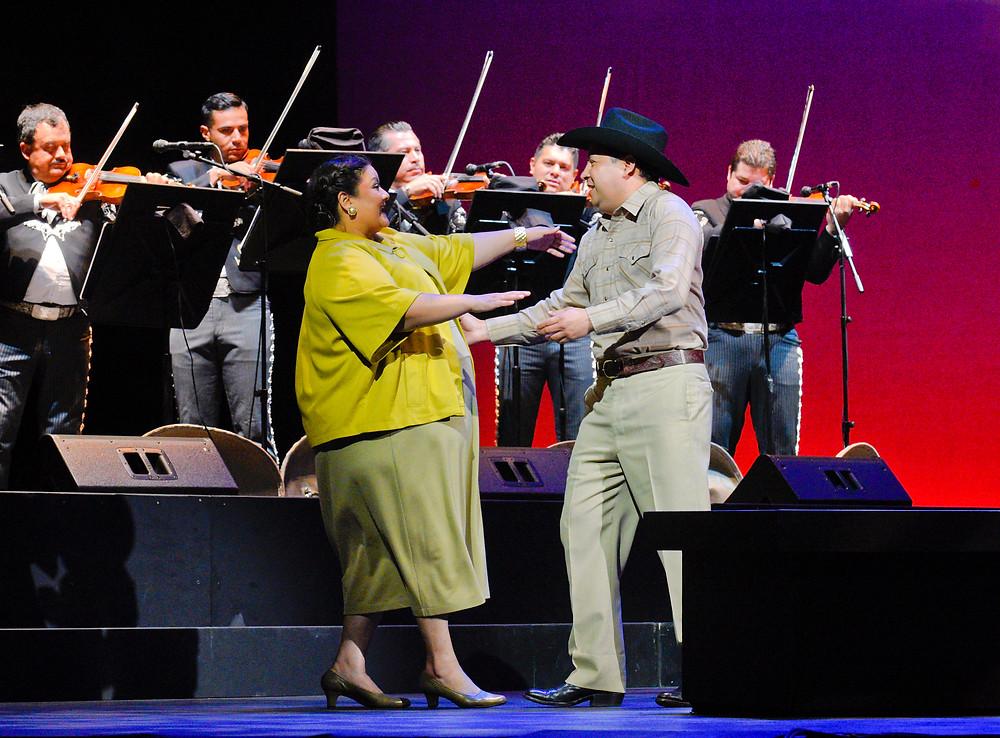 Lupita (Vanessa Cerda-Alonzo) and Chucho (Saúl Ávalos) dancing in front of Mariachi Vargas de Tecalitlán; photo by Karen Almond.