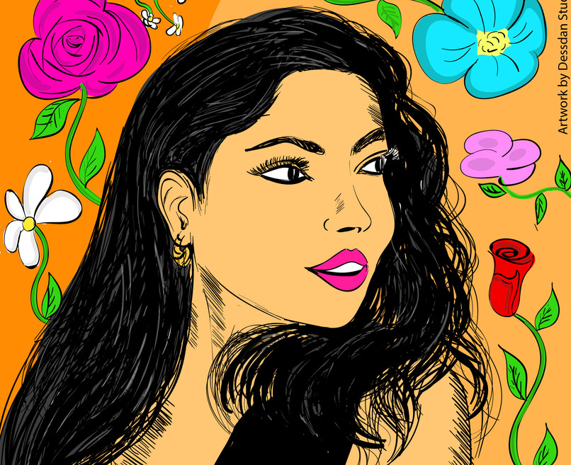 Mujer con flores alrededor de ella.