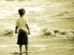 Boy by the ocean