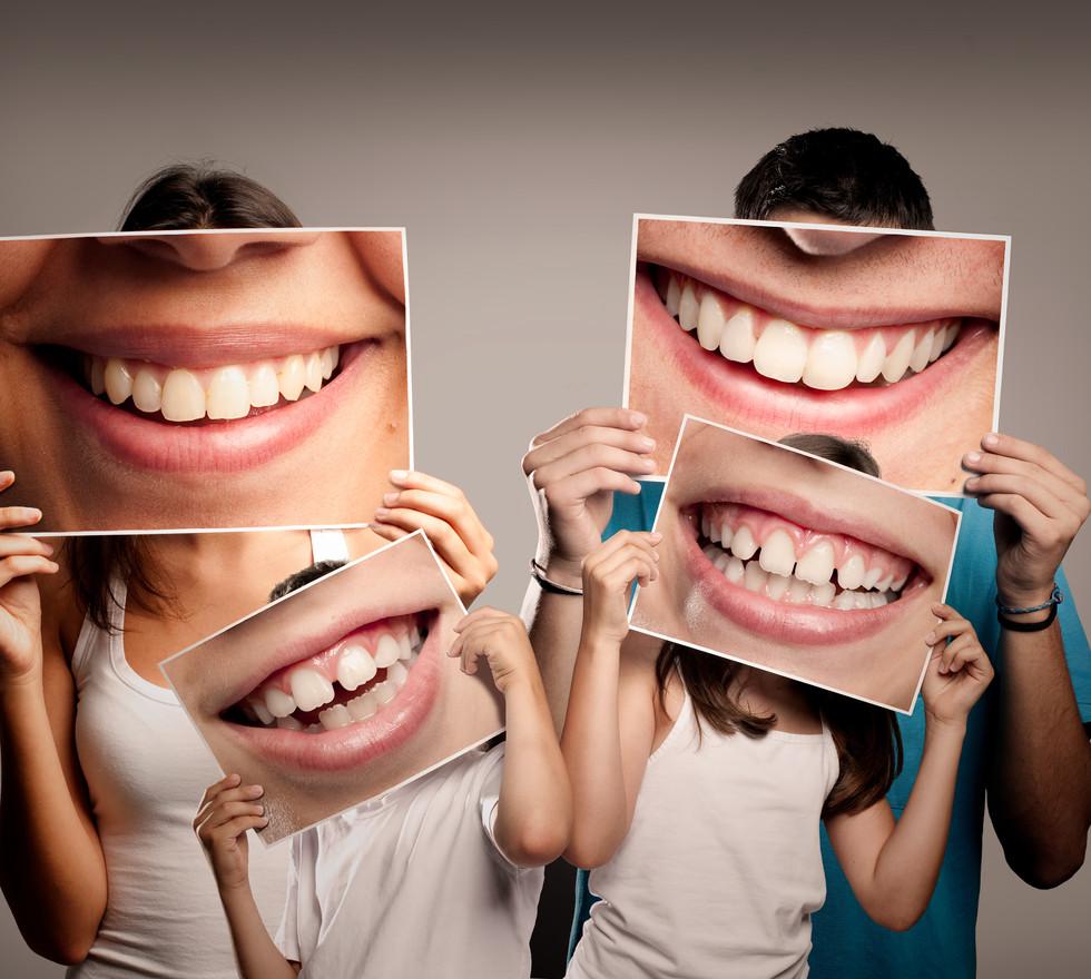 Family holding smile photo.jpg