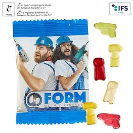 Fruchtgummi in Werkzeug Formen im Werbetütchen mit Wunschdruck