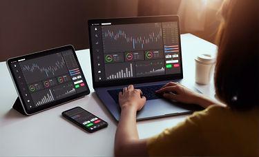 businesswoman-trader-looking-laptop-tabl