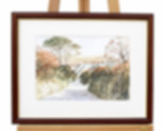 A Giclee Print Of A Watercolour Painting By Harvey Graver Of Down To Carne Beach Showing A Brown Frame With Gold Detail