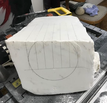 Sketching out where to cut the marble by hand