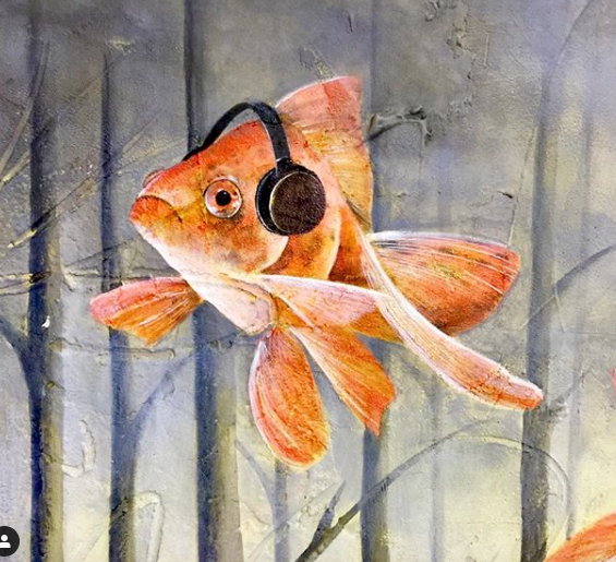 This is a painting of a goldfish wearing headphones by artist Rosita