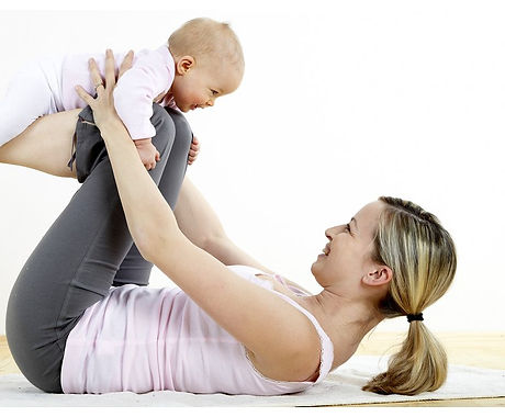 Mother Balancing Baby