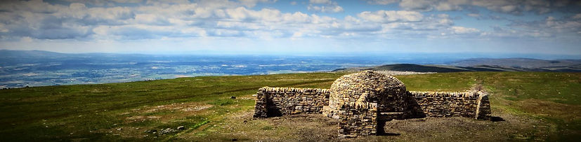 A dry stone cross shelter on the pennine way in cumbria, built by Laurie Lambeth of Lambeth Stonework