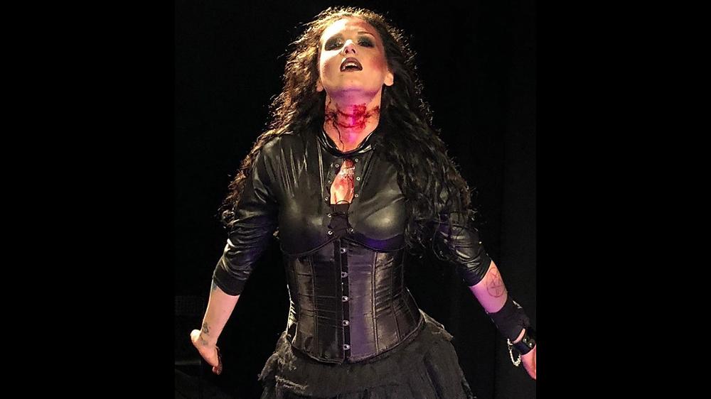 Out lesbian metal rock singer Anastasia Luna on stage