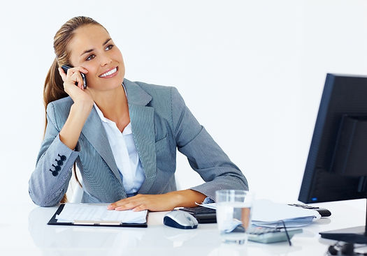 business-woman-on-phone-at-desk.jpg