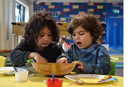 craft sharing siblings.jpg