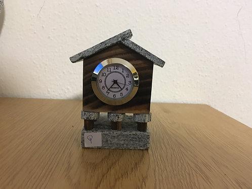 Orologio in legno e sasso, torba