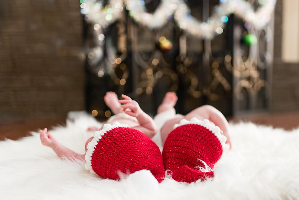 newborn twins in santa hats