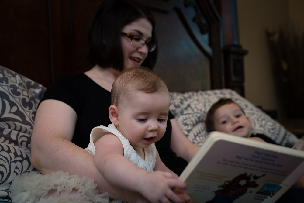 mother reading stories to her babies