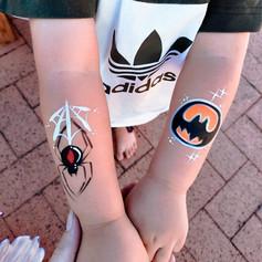 Redback spider and batman logo