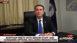 Governor Ralph Northam seated at desk