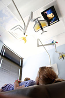Kids love watching movies on the ceiling during dental visits at Daniel C Heard, DDS: Central Arkansas Family Dentistry