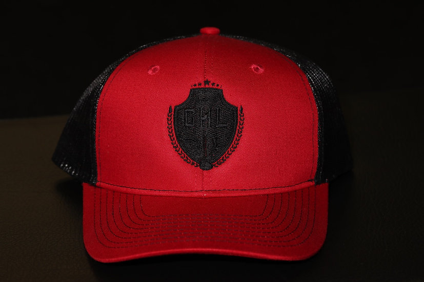 Red and black snap back hat with special edition black on black logo