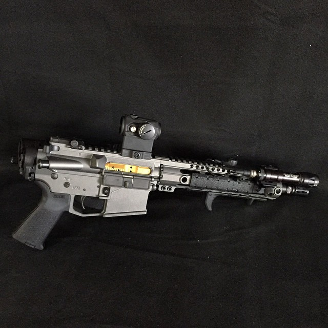 Pistol build for GunsAmerica, finished in Cerakote gun coatings Tungsten Grey