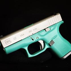 Glock 42 finished in Cerakote Satin Aluminum and Robin Egg Blue