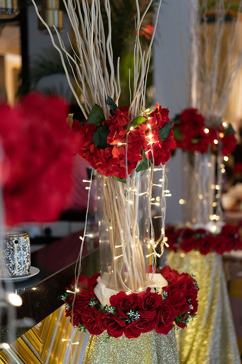 Red, white, and gold floral walkway decoration