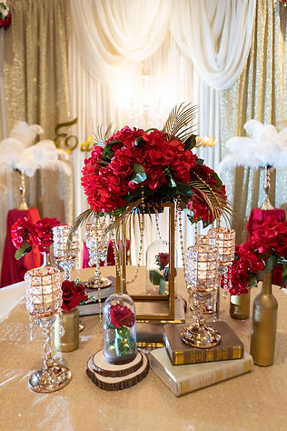 Red, white, and gold VIP table decoration
