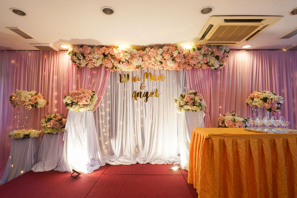 Pink, white, and gold stage backdrop