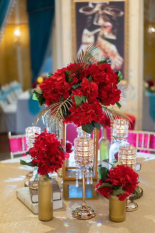 Red, white, and gold VIP table flower decoration