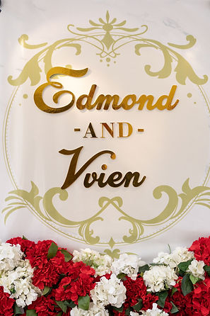 Red, white, and gold couple name backdrop