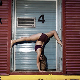 Coral Crawford performs handstands. Learn how to be an acrobat too at island circus space in victoria BC